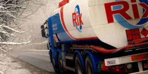 White Blue and Red Rix Oil Lorry Driving Down A Winter Road