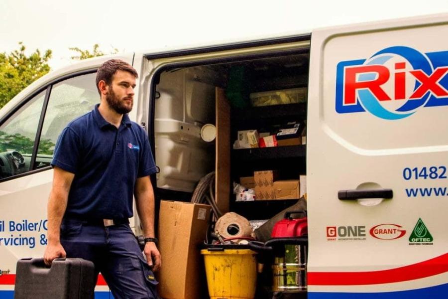 Rix Driver Standing Next to Van