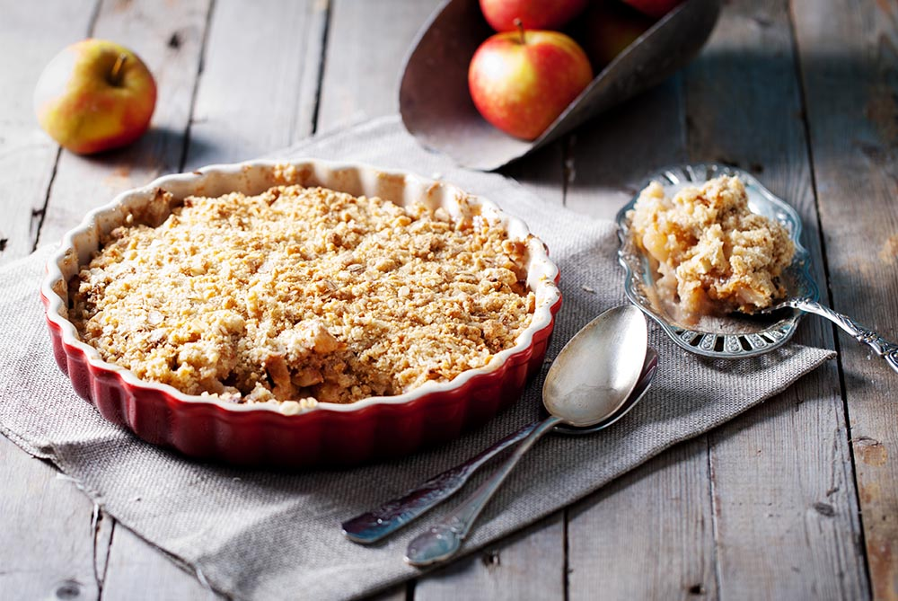 Apple crumble served with a slice cut out