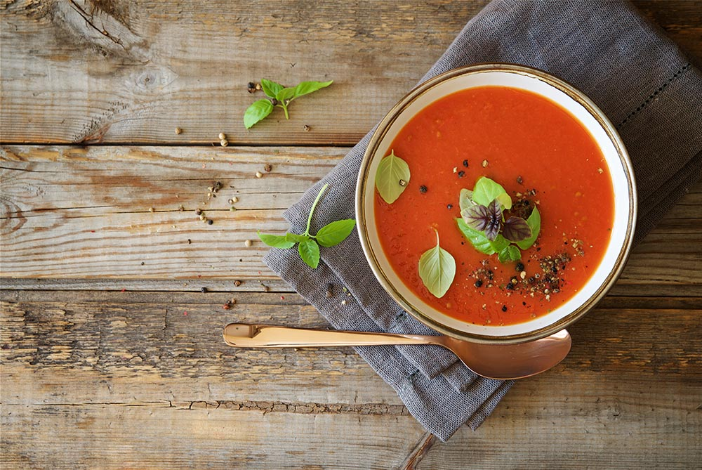Tomato soup ready to eat on a wooden table