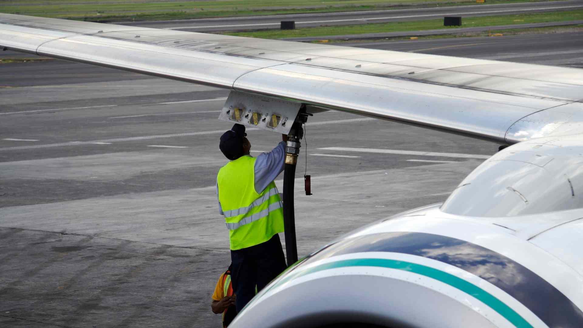 An aeroplane being refuelled with aviation kerosene.