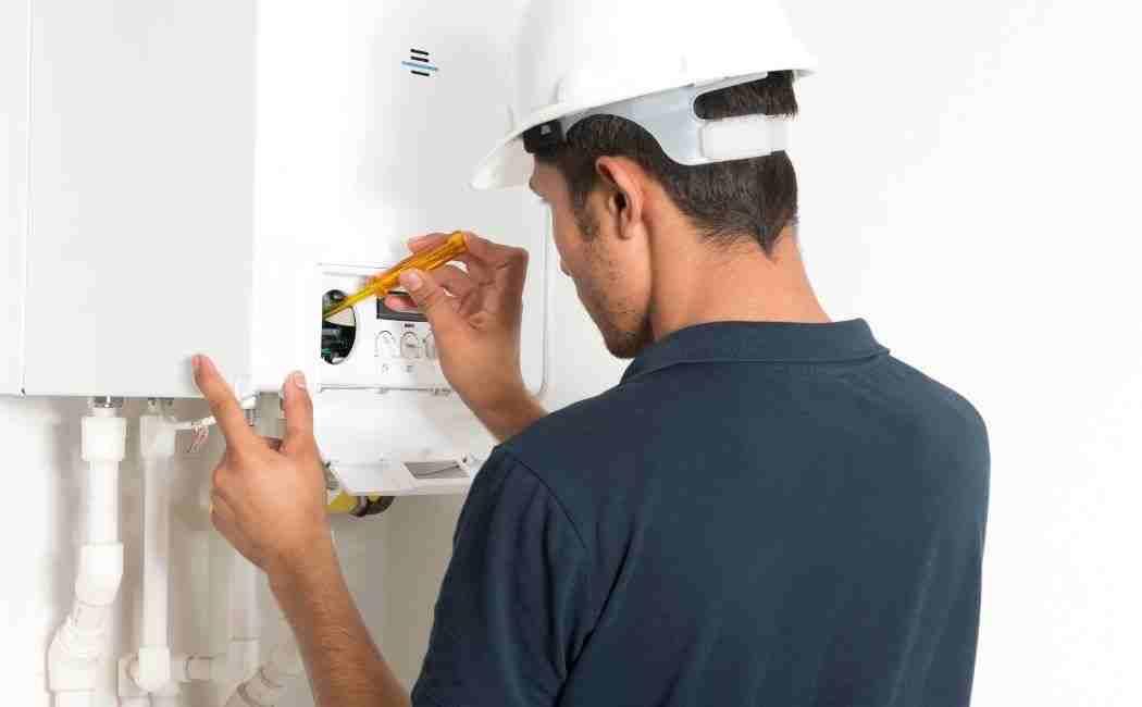 An engineer installing a gas boiler.